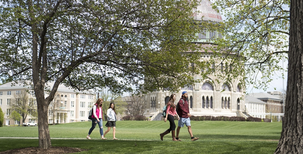 Students walking across campus with the Nott Memorial visible in the background.