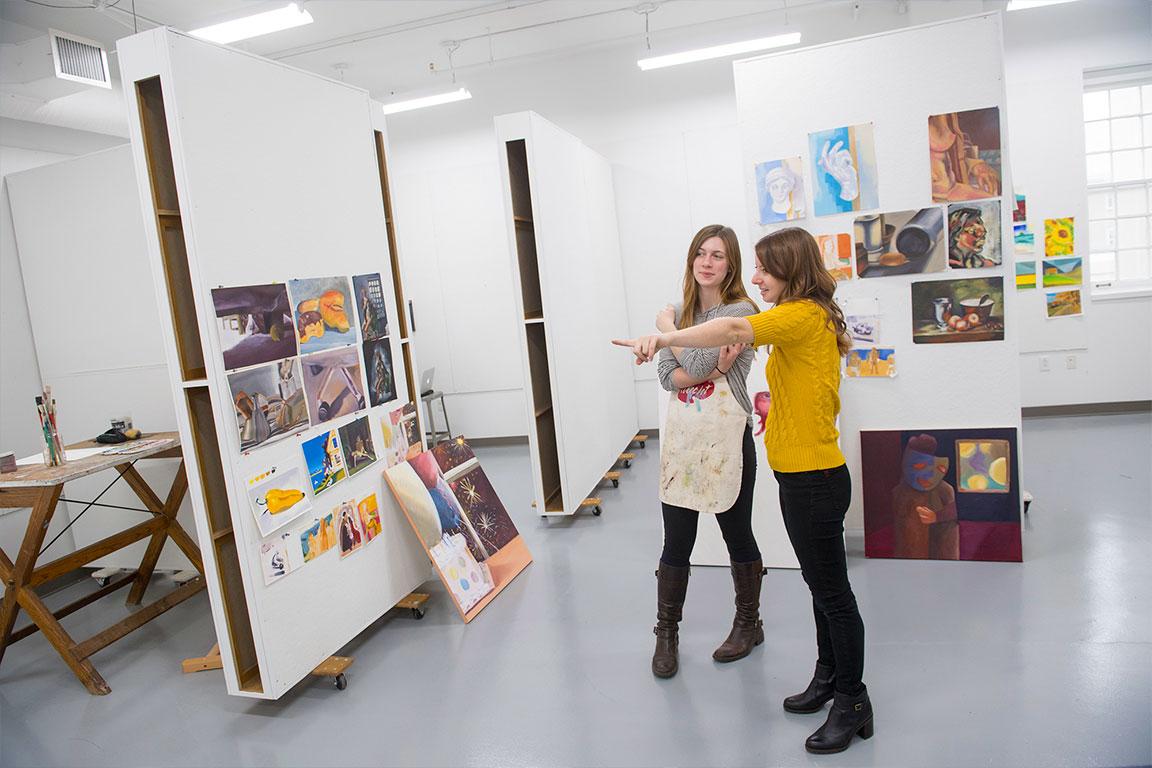 Laini Nemet,visual arts professor, with a student in the painting studio.