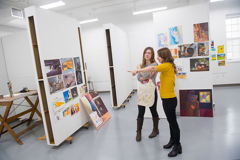 Laini Nemet, visual arts professor, with a student in the painting studio