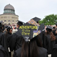 Graduation photo of students outside with Nott Memorial in background
