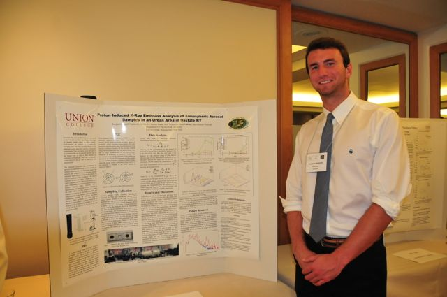 Ben Nadareski next to poster at the 4th Joint Meeting (2014) of the Nuclear Physics Division of the APS