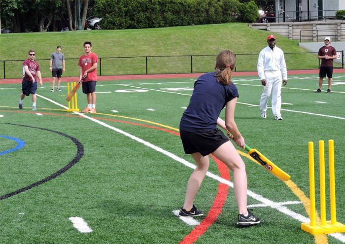 Students learn to play cricket
