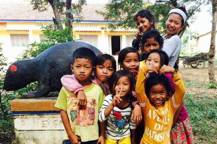 Lakhena Leang '19 with local school children in one of Cambodia's provinces, Kampong Speu. She taught children how to properly wash their hands and brush their teeth, in addition to providing them with basic health checkups.