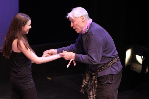 Jacques d'Amboise works with Union dancers as they warm up for the Winter Dance Concert Thursday.