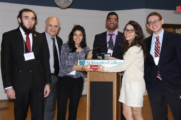 Chalmers Clark, adviser to Union's Ethics Bowl team (second from left) with members Andrew Forte, Raashika Goyal, Sahil Khullar, Dima Yankova and Marc Perlman.