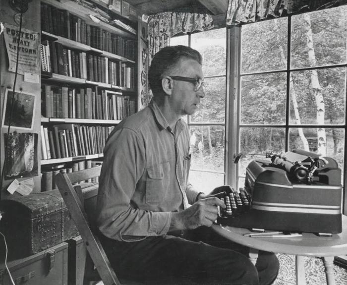 Noted conservationist Paul Schaefer works in his home office in 1950; the home is now part of the Kelly Adirondack Center.