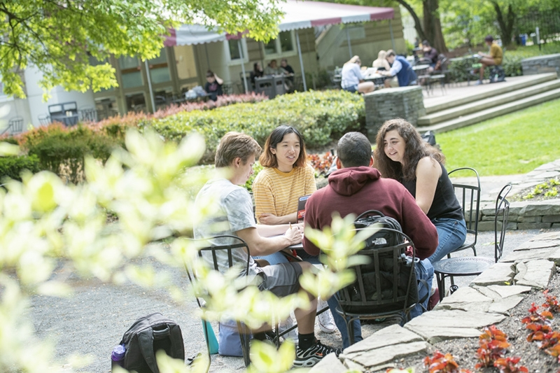 Students enjoying a nice day in the back of Reamer Campus Center.