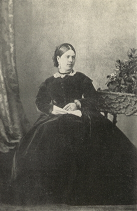Bigelow woman in photo sitting in chair