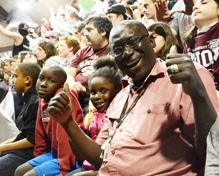 Cheikh Ndiaye and his family enjoy a Union hockey game