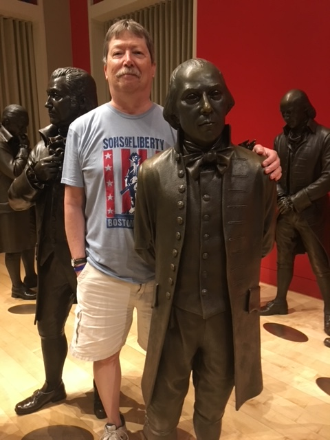 Professor Ken DeBono stands with President James Madison at the National Constitution Center in Philadelphia.
