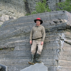 Kurt T. Hollocher standing in front of a large rock formation