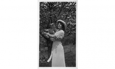 Jeanne Robert Fosters holds a flowering spring branch