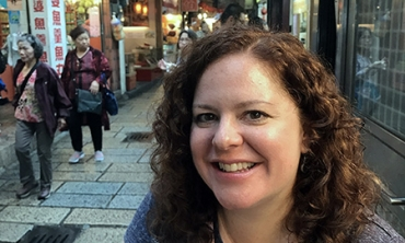 Krisanna M. Scheiter samples food in Jiufen, Taiwan.