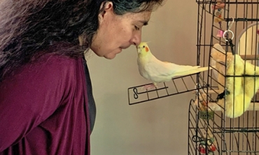 Rebecca (Becky) Cortez, professor of mechanical engineering and director of Engineering at Union, whistles with Maddie, her daughter's cockatiel.
