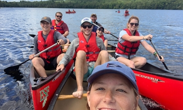 Union College students canoeing Rich Lake in the Adirondack mountains