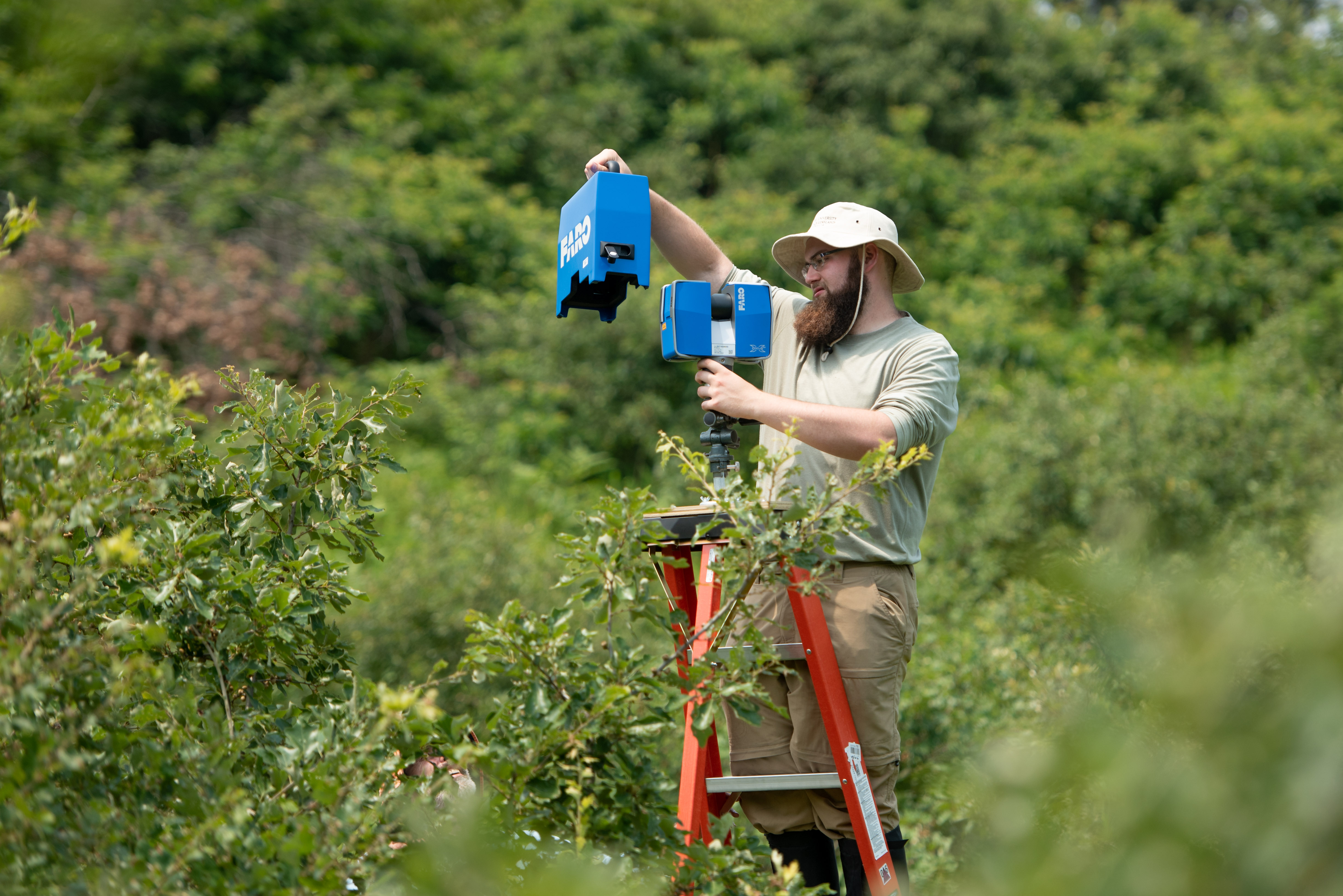 Sean Rigney '20 uses a terrestrial laser scanner to collect 3D images of the shrub structure in the Albany Pine Bush Preserve. Working with Steve Rice, professor of biology, Rigney is among more than 130 students across a multitude of disciplines engaged in a summer research project.