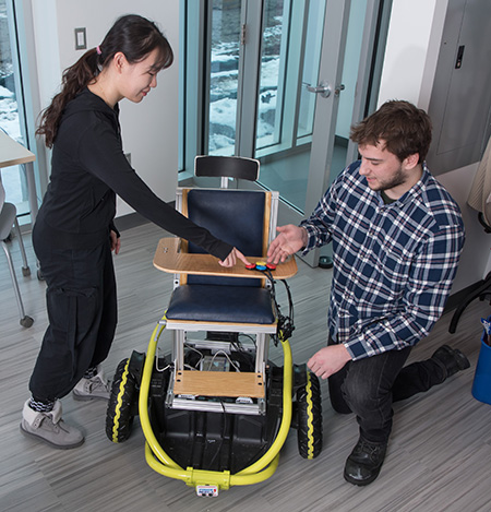 Engineering students Yueyin Su and Benjamin Davis collaborate on the replicable power wheelchair.